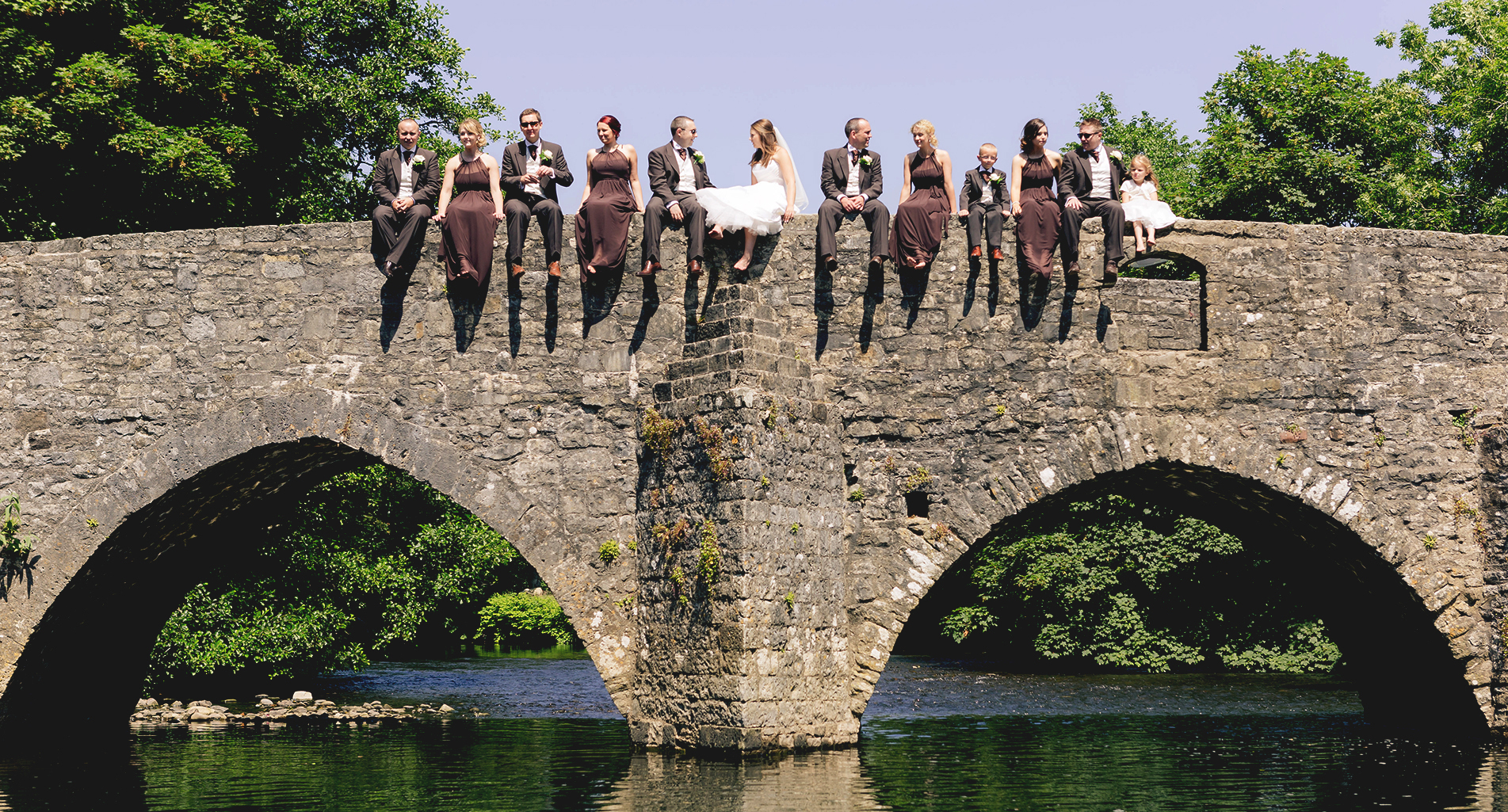 Bridal party on a bridge