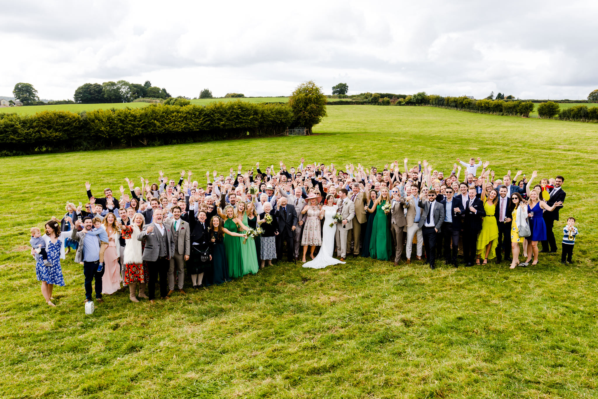 Wedding group photo in field
