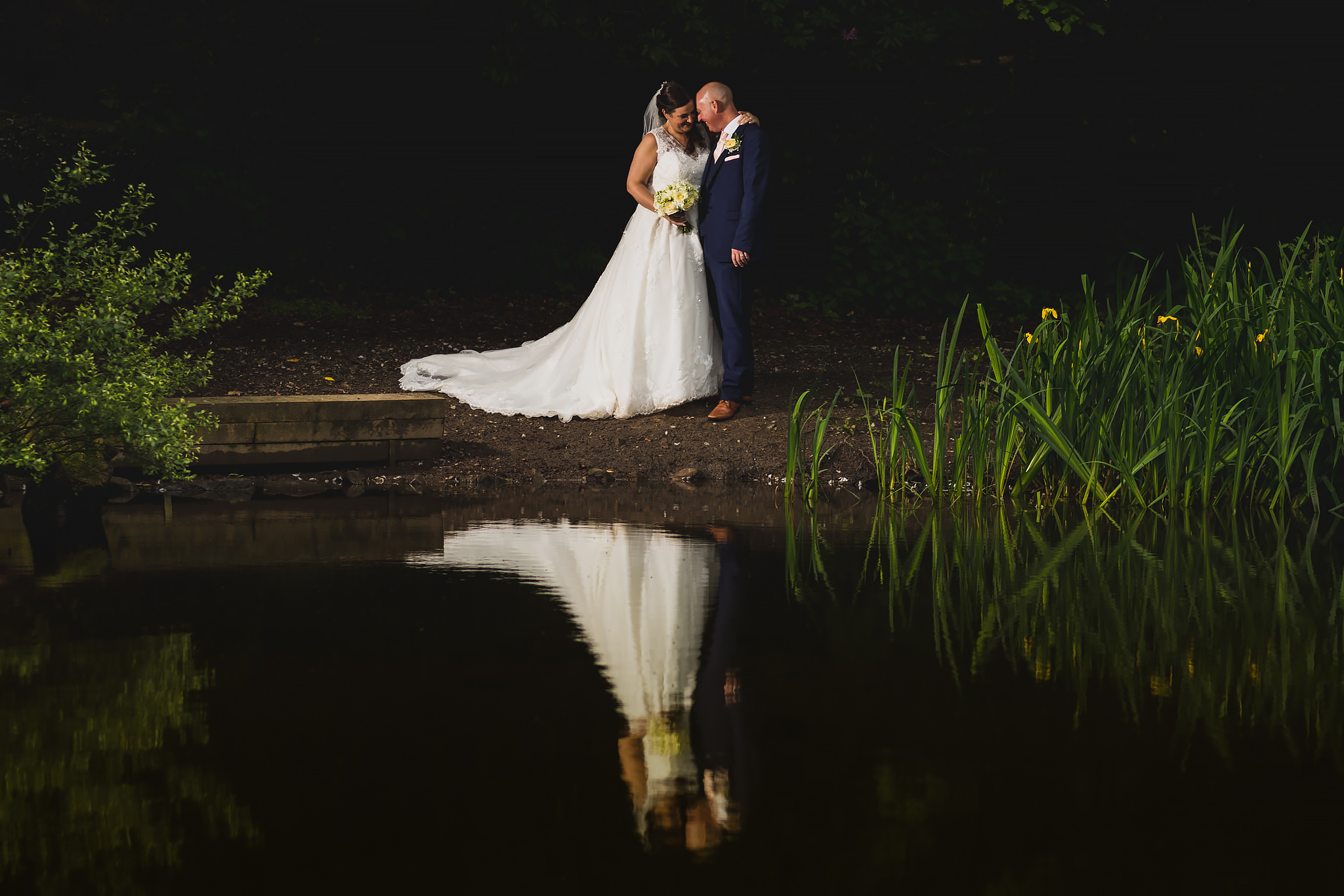 Bryngarw House wedding photography - Bride and Groom by the duck pond