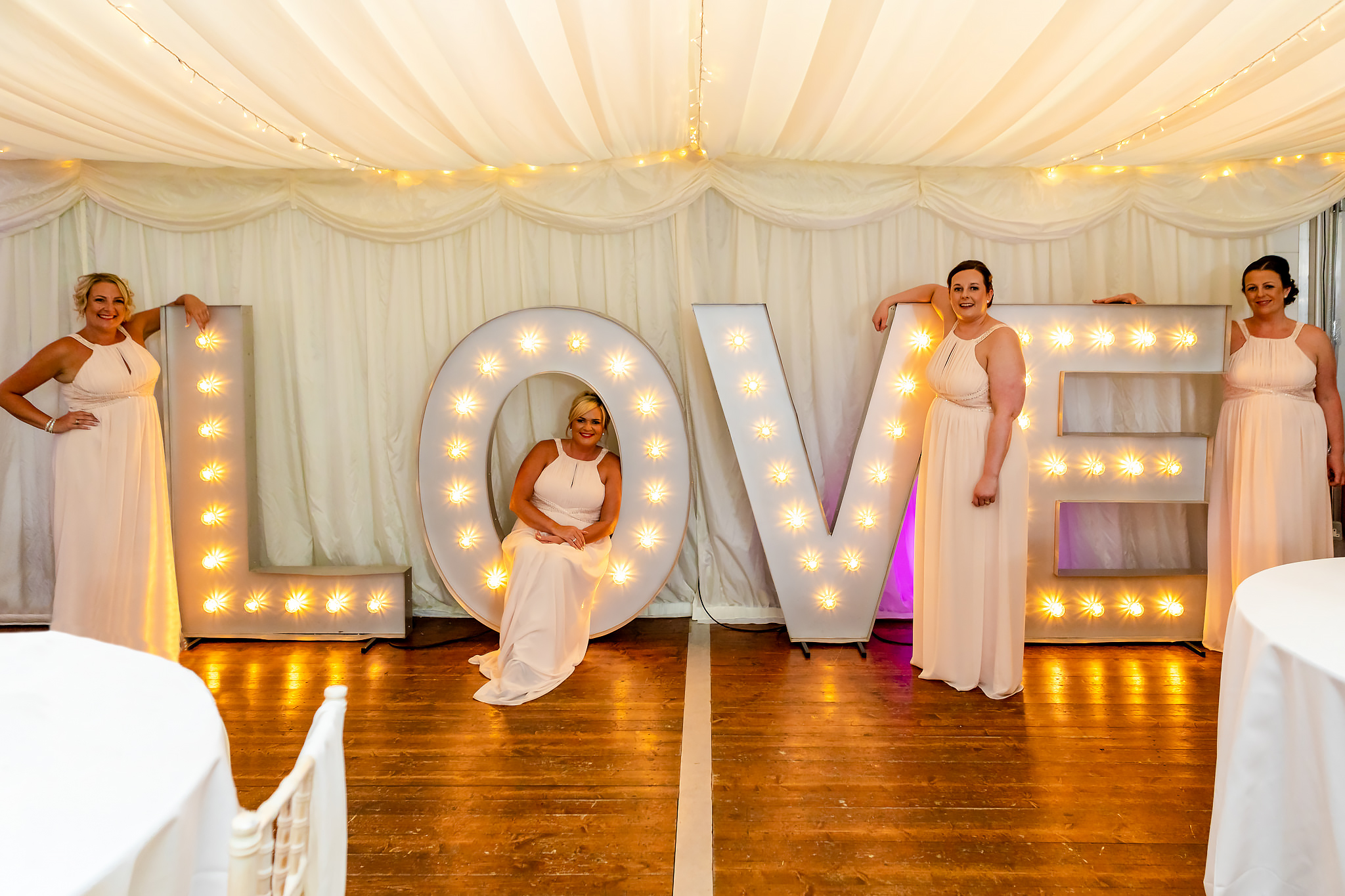 Bryngarw House Wedding Photography - Bridesmaids in Love sign