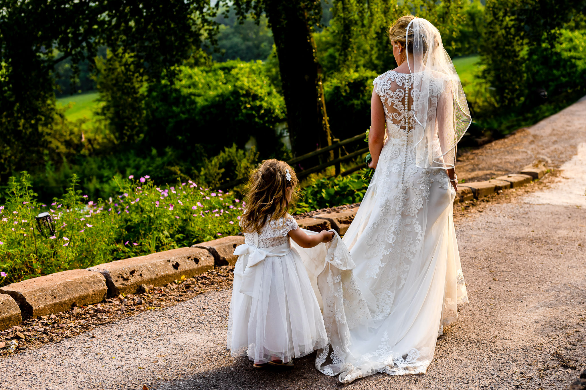 Art by Design - Caer Llan Wedding Photography - Bride and Flowergirl