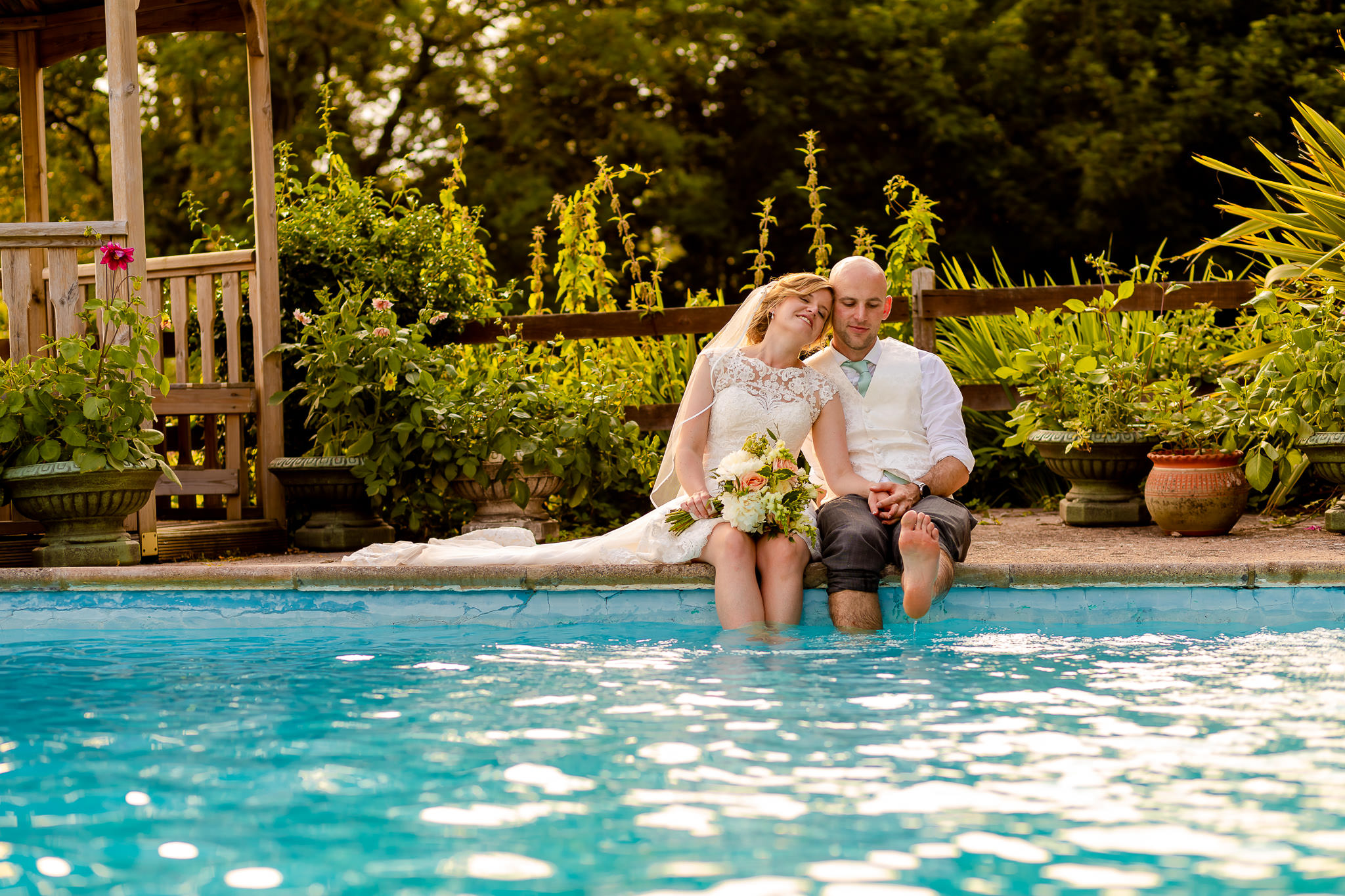Art by Design - Caer Llan Wedding Photography - Bride and Groom in the pool