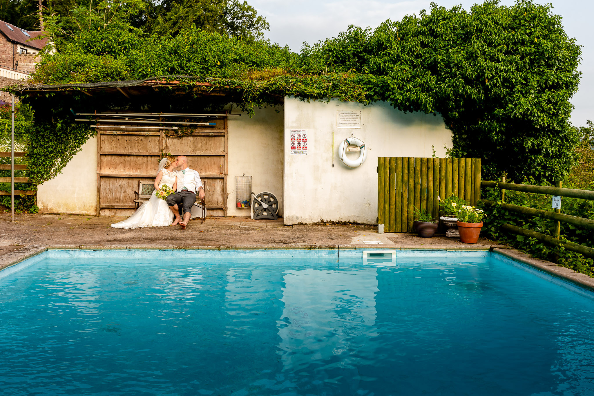 Art by Design - Caer Llan Wedding Photography - Bride and Groom by the pool