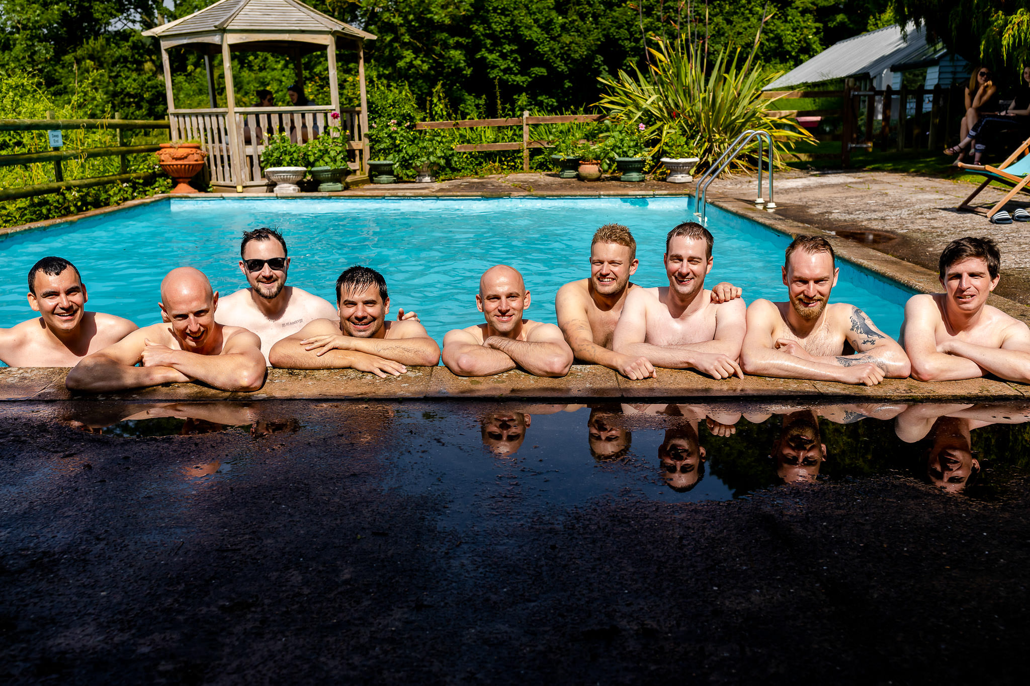Caer Llan Wedding Venue Monmouth - Groomsmen in pool