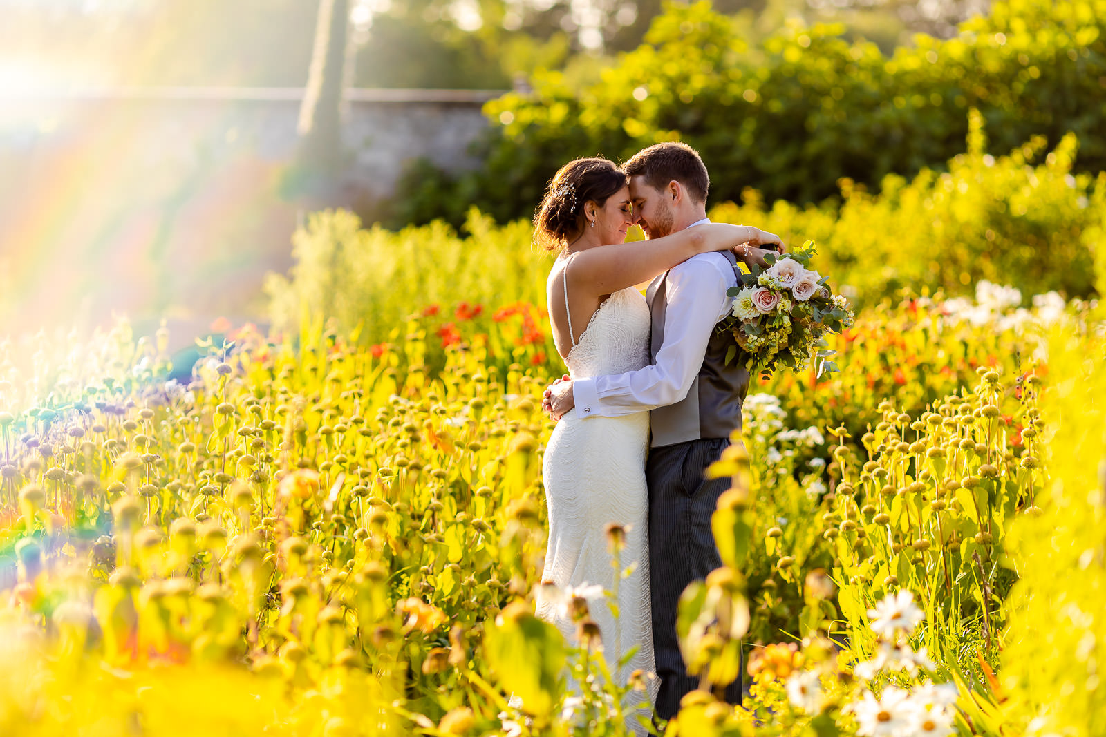 Fonmon Castle Wedding - Bride and Groom in flower garden - Cardiff Wedding Photographer